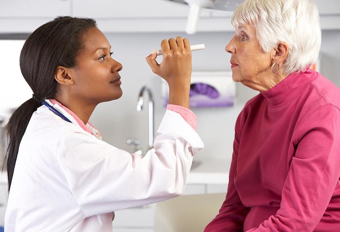 Woman having her eye exam in Jacksonville, FL